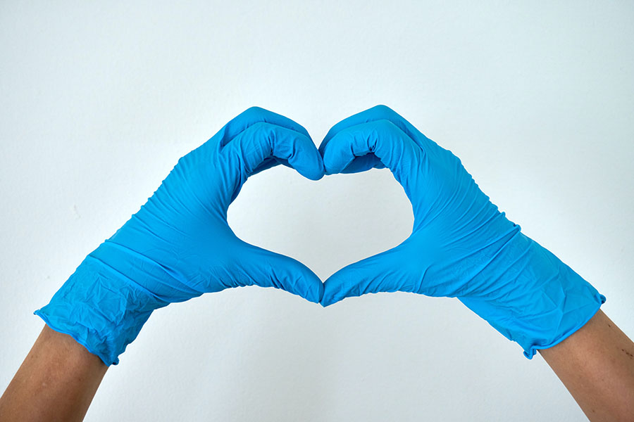 hands with gloves making heart